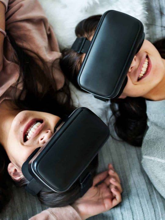 women-experiencing-virtual-reality-with-vr-headset-P8EWPYR.jpg